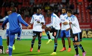 Les Marseillais à l'échauffement avant un match face à Evian, le dimanche 14 septembre 2014.