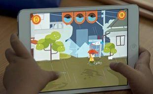 """Les eaux montent. Pour survivre, le petit héros virtuel d'un nouveau jeu video éducatif en Thaïlande """"Flood fighter"""" doit se battre contre les éléments, échapper aux crocodiles et à la noyade; photo prise le 13 mars 2014"""