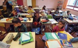 """A moins de deux mois des municipales, les mairies de gauche refusent d'organiser le service minimum dans les écoles pour la grève des fonctionnaires jeudi, alors qu'environ """"2.000 villes"""" vont """"expérimenter"""" cet accueil des élèves, selon le ministre de l'Education Xavier Darcos."""