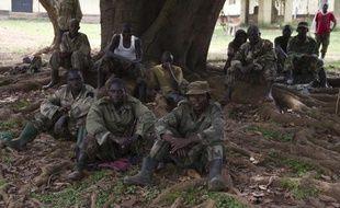 Des membres démobilisés de la rébellion congolaise du M23 dans un campement en Ouganda, le 7 février 2014
