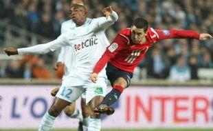 Eden Hazard, auteur du premier but lillois, face àCharles Kaboré, le 6 mars 2011, à Marseille.