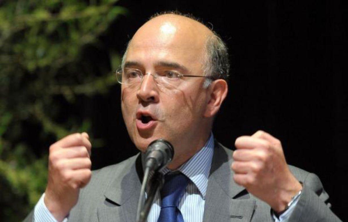 """Le ministre des Finances Pierre Moscovici a estimé dimanche que la question d'une sortie de la Grèce de la zone euro """"se posera sans doute"""", si le pays revient sur ses engagements à l'austérité pris auprès de l'UE et du FMI en cas d'arrivée au pouvoir de la gauche radicale. – Frederick Florin afp.com"""