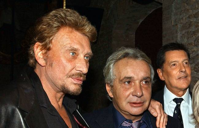 Johnny Hallyday et Michel Sardou en 2002.