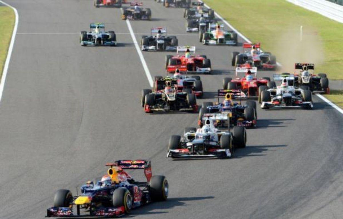 L'Allemand Sebastian Vettel (Red Bull) a remporté dimanche le Grand Prix du Japon, 15e manche du Championnat du monde de Formule 1, devant le Brésilien Felipe Massa (Ferrari) et le Japonais Kamui Kobayashi (Sauber), sur le circuit de Suzuka. – Toshifumi Kitamura afp.com