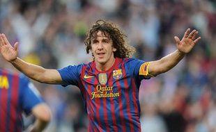 Carles Puyol le 3 mai 2012, montre sa joie après avoir marqué un but contre Malaga au Camp Nou.