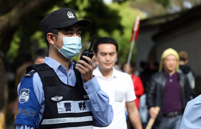 648x415 un policier en chine illustration