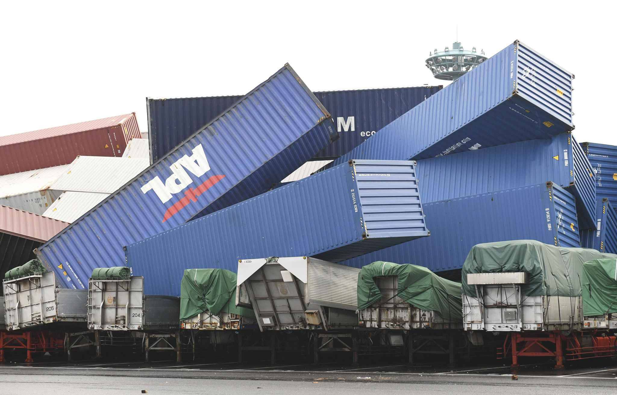 Containers are heaped on trailers due to a strong wind caused of the typhoon Jebi is pictured in Osaka on Sep.4, 2018. Powerful typhoon made a landfall on Tokushima Prefecture in noon and expected to proceed to the Sea of Japan. Violent winds, high waves and heavy rains are forecasted in wide area of Japan till next day.
