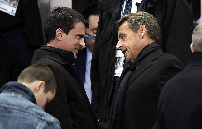 Manuel Valls and Nicolas Sarkozy before the meeting between PSG and Lyon at the Stade de France on 19 April 2014.