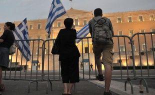 """La reprise de l'économie grecque prévue pour 2014 dépend """"de la poursuite du plan d'ajustement budgétaire"""" ou plan de rigueur dicté par les créanciers du pays, dont l'Union européenne et le FMI, a estimé lundi le gouverneur de la Banque de Grèce (BdG) Georges Provopoulos."""