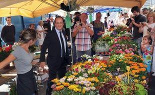 François Hollande sur un marché de Tulle, le 31 juillet 2012.