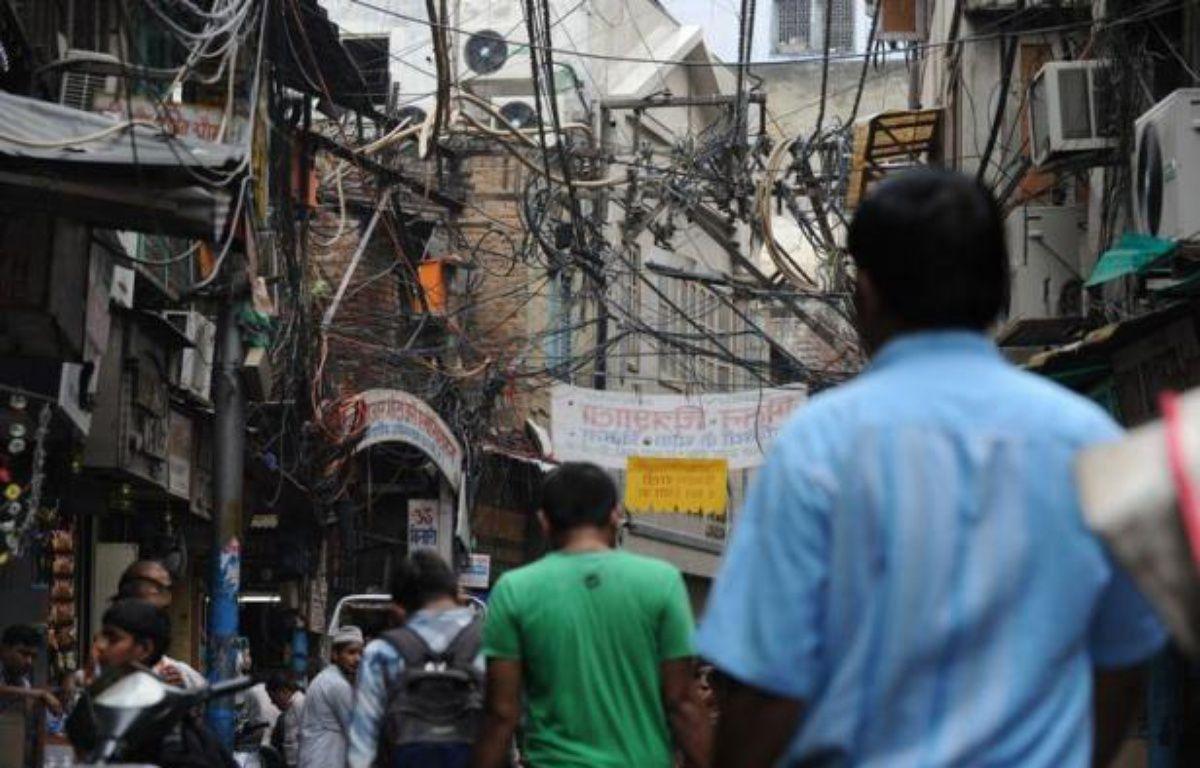 L'Inde est en quête de nouvelles sources d'approvisionnement énergétique pour alimenter sa croissance. Les coupures de courant y sont extrêmement fréquentes mais elles ne sont en général que d'assez courte durée. – Sajjad Hussain afp.com