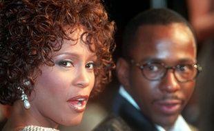 Whitney Houston et son mari Bobby Brown en 1997