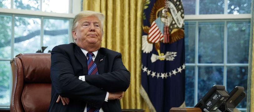 Donald Trump, les bras croisés dans le bureau ovale de la Maison Blanche, le 27 août 2018.