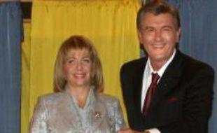 La formation de Mme Timochenko et celle du président Viktor Iouchtchenko, alliés lors de la Révolution orange pro-démocratique de 2004, obtiennent un total cumulé de 44,9% à 45,7% des suffrages, selon trois sondages de sortie des urnes.