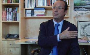 François Hollande, dans son bureau de l'Assemblée nationale, le 5 septembre 2011.