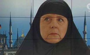 La chancelière allemande Angela Merkel, portant un voile grâce à un photomontage de la chaîne ARD, en octobre 2015.