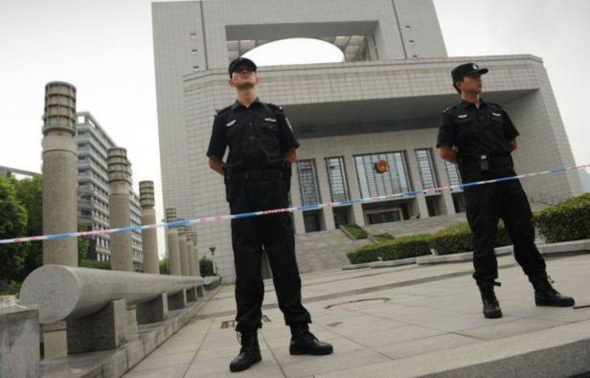 Quatre responsables policiers chinois jugés vendredi ont reconnu avoir sabordé une enquête sur l'assassinat d'un homme d'affaires britannique, pour tenter d'épargner Gu Kailai, l'épouse d'un ex-dirigeant accusée de ce meurtre. – Peter Parks afp.com