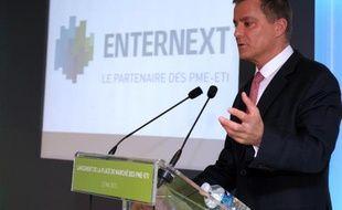 """Dominique Cerutti, alors directeur général adjoint et administrateur de NYSE Euronext, lors de la conférence de presse de lancement d'""""EnterNext"""", à Paris, le 23 mai 2013"""