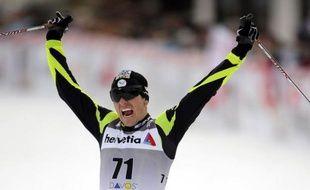 Le Norvégien Petter Northug, champion olympique et du monde, a remporté samedi le 30 km de Davos comptant pour la Coupe du monde de ski de fond, devant le Français Maurice Manificat et le Tchèque Lukas Bauer.