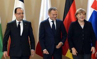 La chancelière allemande Angela Merkel, le président français François Hollande et Donald Tusk, nommé depuis samedi au poste de président du Conseil européen.