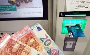 Photo illustration d un distributeur de billets de banque.
