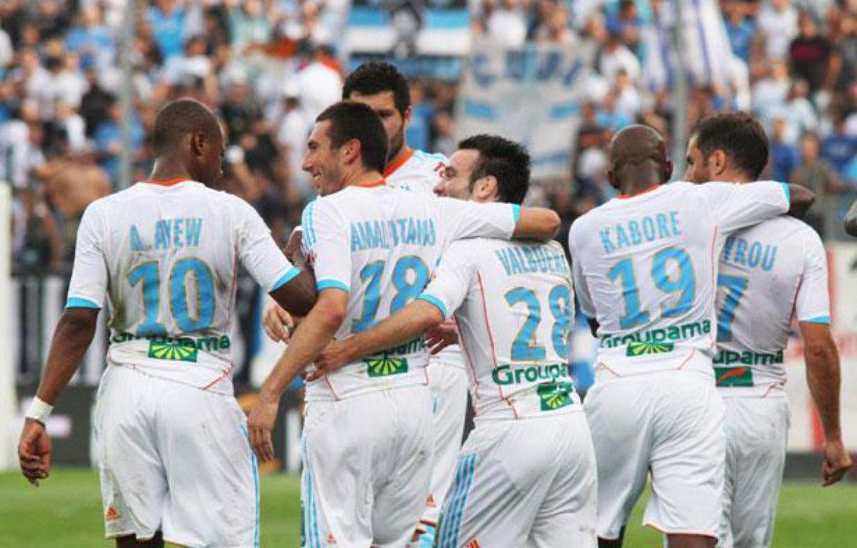 L'Olympique de Marseille fête le but de Morgan Amalfitano contre Evian-Thonon-Gaillard, le 23 septembre 2012 au stade Vélodrome. – VILLALONGA KARINE/SIPA