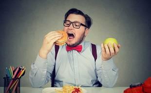 « Je devrais manger plus équilibré mais ce burger a quand même l'air méga appétissant...» Voilà un choix cornélien.