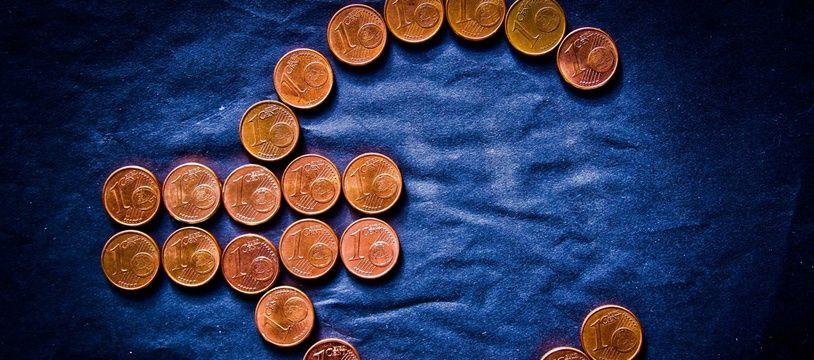 Des pièces d'un centime d'euro.