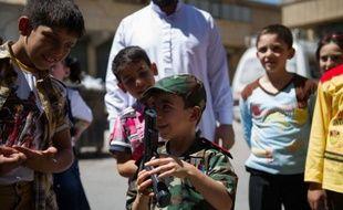 En Syrie, plongée dans les violences depuis près d'un an et demi, les morts n'auront pas de fleurs sur leur tombe et les enfants pas de douceurs dans leurs poches cette année pour l'Aïd al-Fitr, la fête marquant la fin du jeûne du Ramadan.