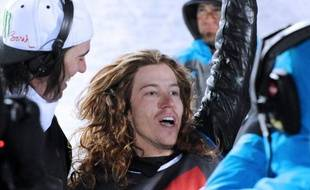USA's Shaun White celebrates after winning the Men's Snowboard Superpipe final of the European Winter X-Games, on March 15, 2012 in the sky resort of Tignes. AFP PHOTO JEAN-PIERRE CLATOT