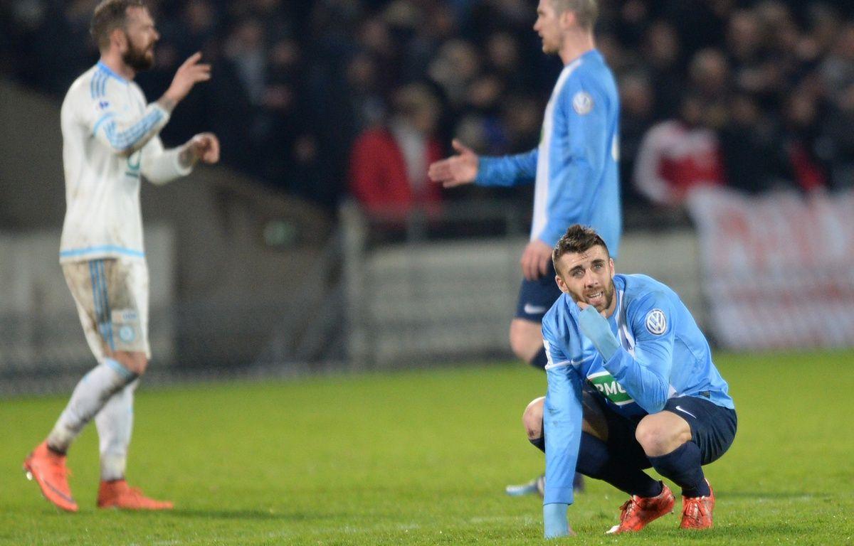 Les joueurs de Trélissac éliminés par l'OM en 8e de finale de Coupe de France au stade Chaban-Delmas de Bordeaux, le 11 février 2016. – N. Tucat / AFP