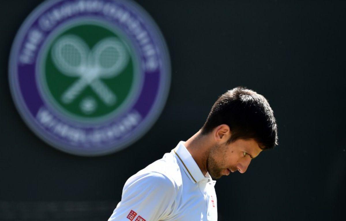 Djokovic a la tête basse après sa défaite – GLYN KIRK / AFP