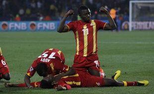Le Ghanéeen Sulley Muntari célébre le but de son équipe, le 26 juin 2010 à Rustenburg.