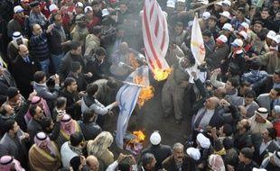 """Bombardés, humiliés puis coupés du reste de l'Irak: les habitants de Fallouja ont payé le prix fort des deux formidables batailles qui ont opposé en 2004 l'armée américaine aux insurgés sunnites, et sont impatients de voir l'""""occupant"""" quitter leur pays."""