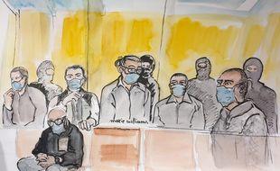 Ali Riza Polat, à droite, écoute l'énoncé du verdict du procès des attentats de janvier 2015