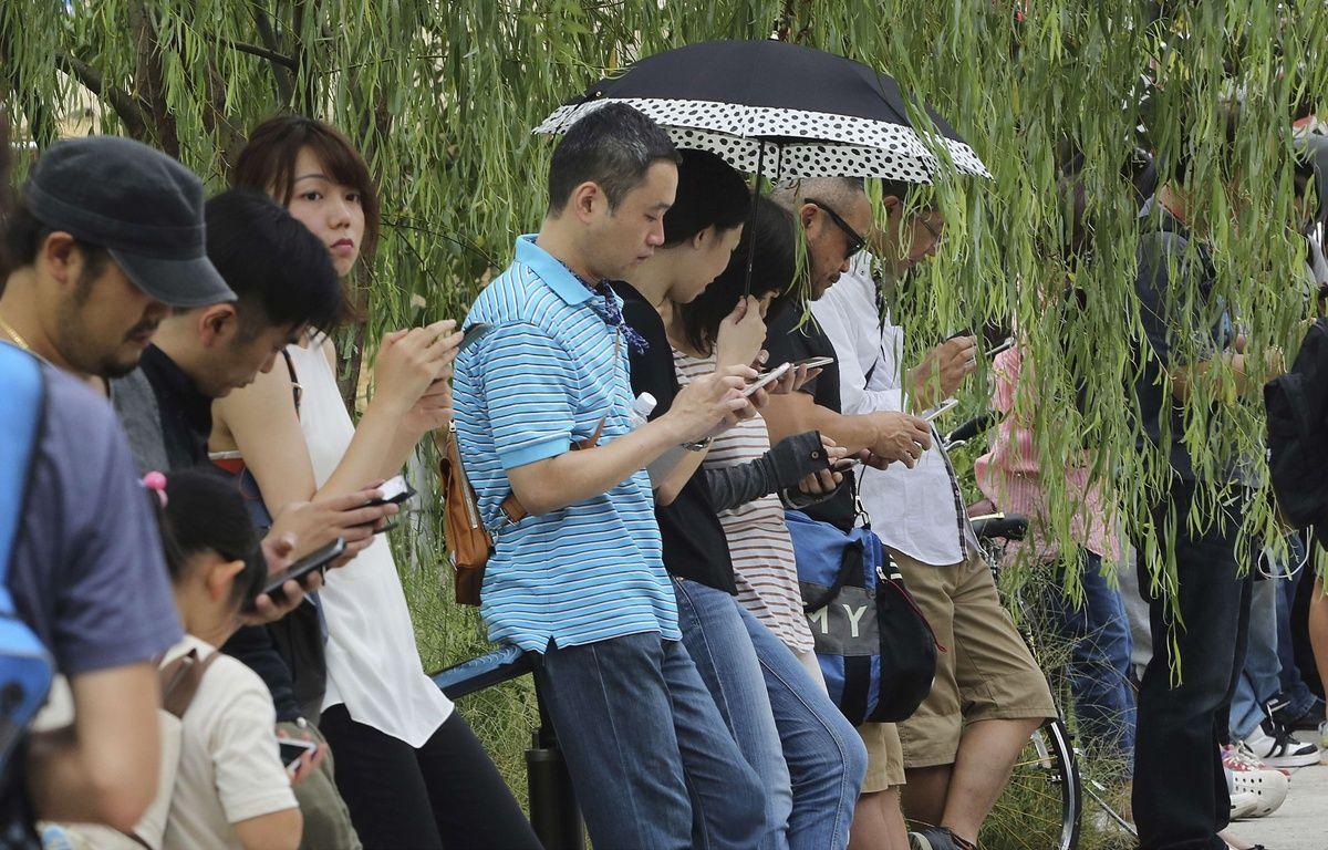 Des joueurs de «Pokémon GO» au parc d'Ueno à Tokyo (illustration). – Koji Sasahara/AP/SIPA