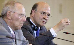 """Satisfait du message """"très positif"""" de Berlin sur la Grèce, le ministre des Finances Pierre Moscovici prévient, dans un entretien à l'AFP, qu'une sortie d'Athènes de l'euro provoquerait une contagion imprévisible et qu'il faut donc """"tout faire"""" pour l'éviter."""