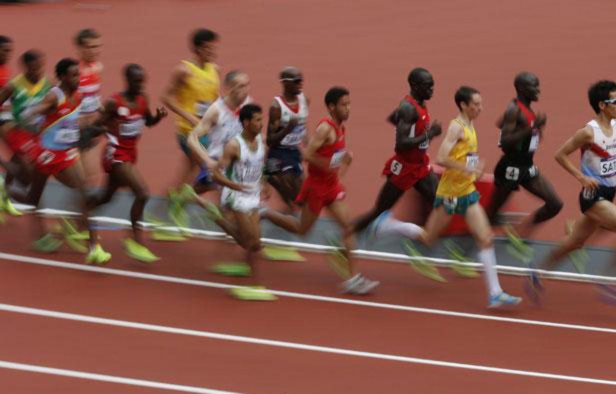 Une série du 5000m des jeux olympiques à la quelle participait le Français Hassan Hirt, le 8 août 2012, à Londres. – REUTERS