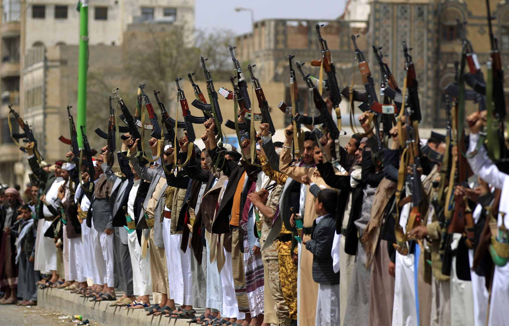 Supporters of the Shiite Yemeni Huthis demonstrate in the capital Sanaa on 25 June 2018, in support of fellow Huthis engaged in battles against the coalition forces led by the UAE and Saudi Arabia in Red Sea port city of Hudeida.