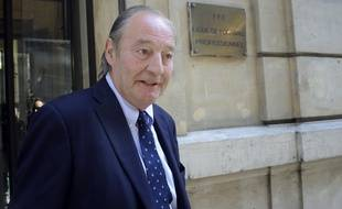 Lens' Ligue 2 football club President Gervais Martel leaves after an hearing by the DNCG (Direction nationale du controle de gestion), the financial branch of the Ligue de Football Professionnel (French National Professional Football players Union) in Paris on June 10, 2015. Relegated to Ligue 2 but threatened to plunge even lower by the errors of his Azerbaijani owner, RC Lens plays its future today at the DNCG, financial policeman of French football. AFP PHOTO / THOMAS OLIVA