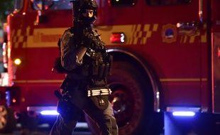 Un policier des forces spéciales à Toronto, après une fusillade qui a fait deux morts et 13 blessés, le 22 juillet 2018.