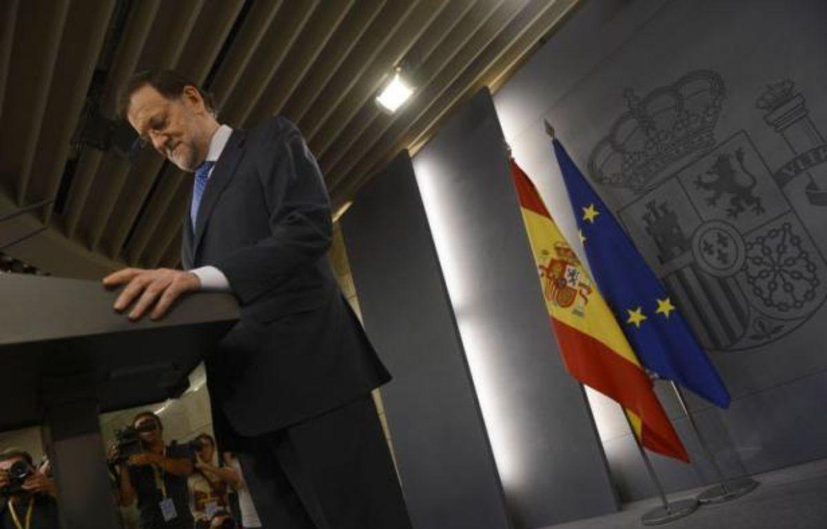 L'Espagne a annoncé vendredi un plan prévoyant cent milliards d'euros d'économies d'ici à 2014, mais, toujours asphyxiée sur les marchés malgré cet effort de rigueur, elle n'exclut plus une demande d'aide financière à ses partenaires européens. – Pierre-Philippe Marcou afp.com