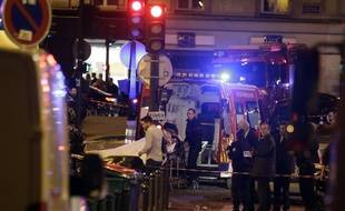 An injured person is evacuate following an attack in the 10th arrondissement of the French capital Paris, on November 13, 2015. At least 18 people were killed as multiple shootings and explosions hit Paris, police said. Police also said there was an ongoing hostage crisis in the Bataclan a concert hall in the French capital. AFP PHOTO / KENZO TRIBOUILLARD