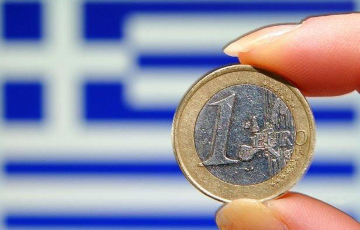 """L'agence de notation financière Standard and Poor's voit """"au moins une chance sur trois"""" que la Grèce sorte de la zone euro, selon un rapport publié lundi où elle relativise toutefois les risques de contagion. – Philippe Huguen afp.com"""