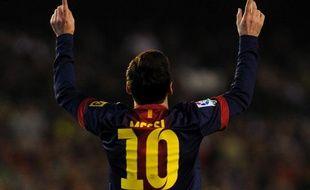 Lionel Messi après avoir égalé le record de but de Gerd Müller, à Seville, le 09 décembre 2012.