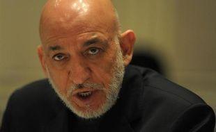 """Des services secrets étrangers sont """"derrière"""" l'attaque suicide qui a fait 21 morts vendredi soir à Kaboul, a affirmé dimanche le Conseil de sécurité nationale afghan, présidé par le président Hamid Karzaï, une accusation semblant viser le Pakistan voisin."""