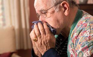 Illustration d'un homme malade de la grippe.