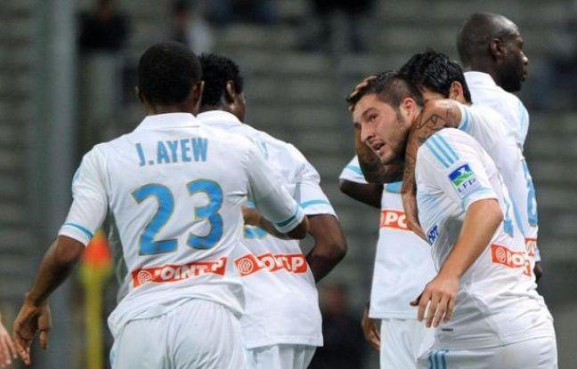 L'Olympique de Marseille, double tenant du titre, est venu à bout (4-0) sans forcer de Lensois limités, mardi en 8e de finale de la Coupe de la Ligue, grâce notamment au premier but de la saison d'André-Pierre Gignac et à un doublé de Loïc Rémy.