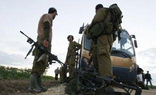 L'armée israélienne a entamé dimanche un retrait progressif de la bande de Gaza après l'instauration d'un cessez-le-feu dans le territoire palestinien, ravagé par 22 jours d'une offensive meurtrière
