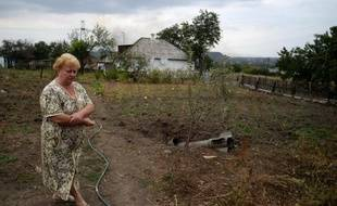 Une habitante de Troïtsko-Khartsizk en Ukraine, le 28 août 2014